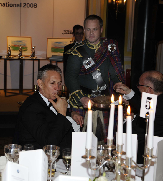 Bagpiper Bryce McCulloch Addresses the Haggis with Gary Lineker as host.