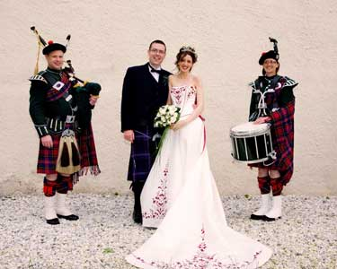 Bagpiper Bryce McCulloch and drummer Marcia Thomson, courtesy of David Gilbert, Stewarton